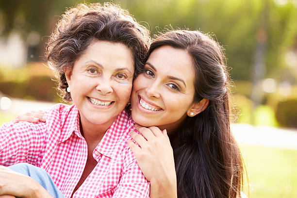 mother with adult daughter in park together - daughter stock photos and pictures