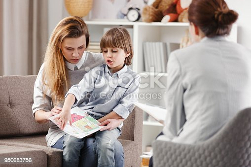istock Mother with autistic child 950683756