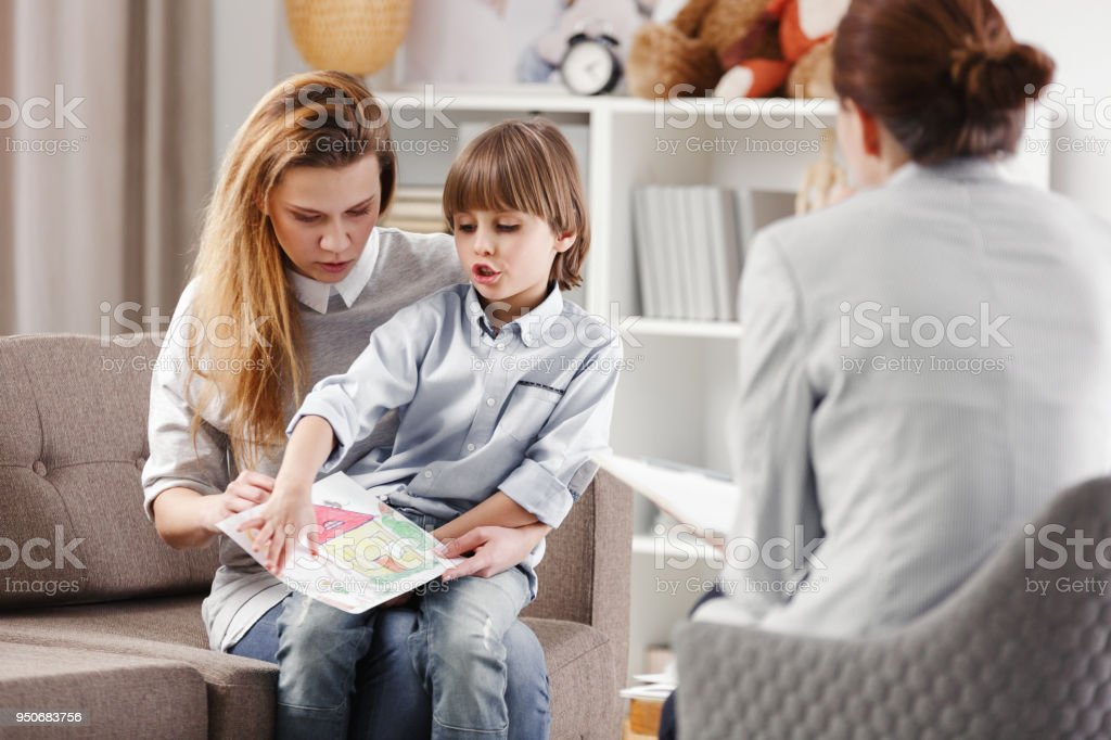 Mother with autistic child stock photo