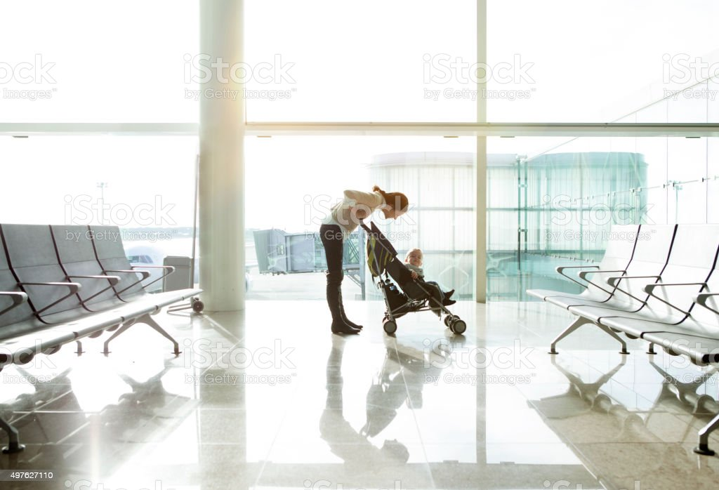 Mother with baby at the airport stock photo