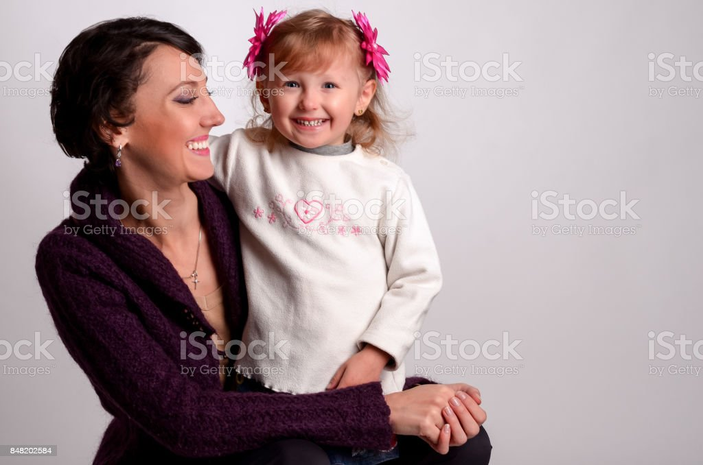 Mother with baby girl on white background stock photo