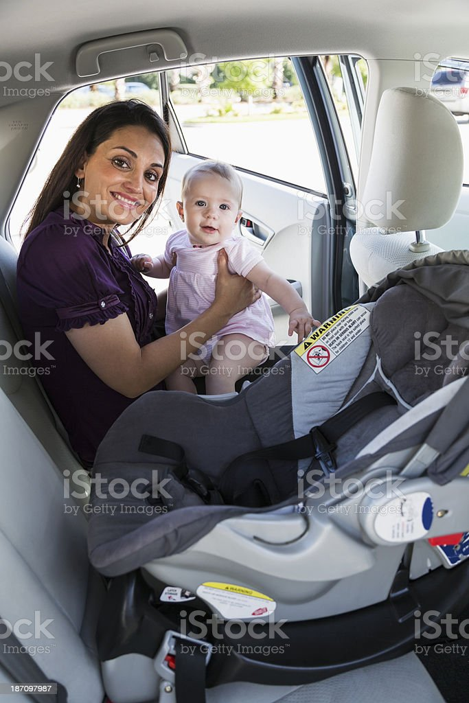 Mother with baby in back seat of car stock photo