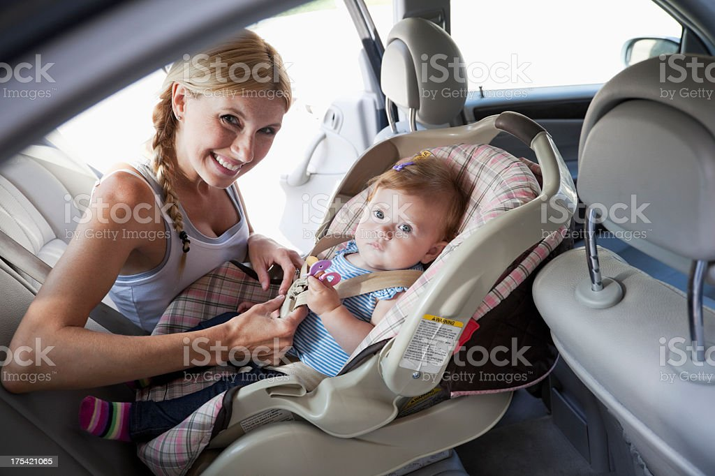 Mother with baby in car seat royalty-free stock photo