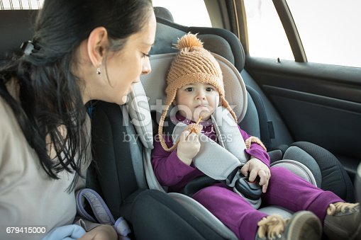 istock Mother with baby in car seat 679415000