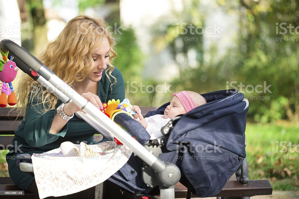 Mother with baby in pram stock photo