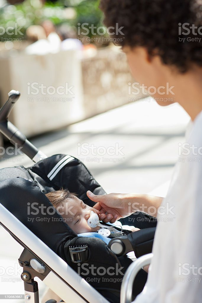 Mother with baby in stroller royalty-free stock photo