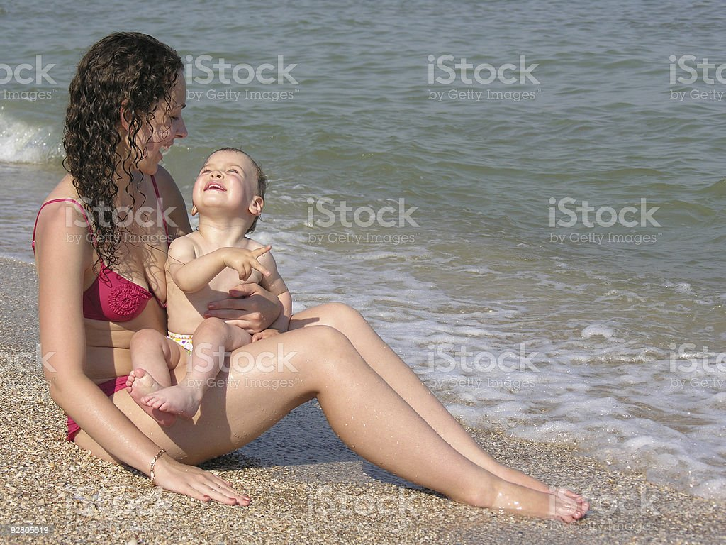 mother with baby on beach royalty-free stock photo