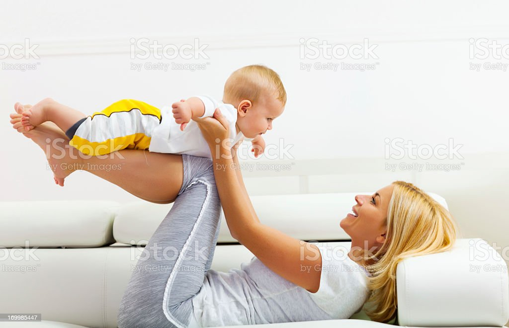 Mother with baby on the couch royalty-free stock photo