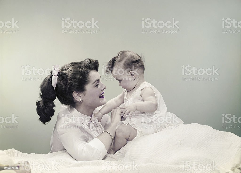 Mother with baby, smiling stock photo