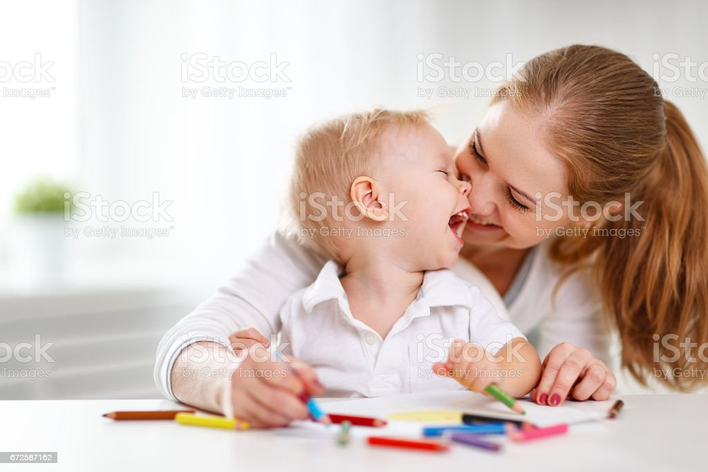 Mother with baby son with colored pencils stock photo