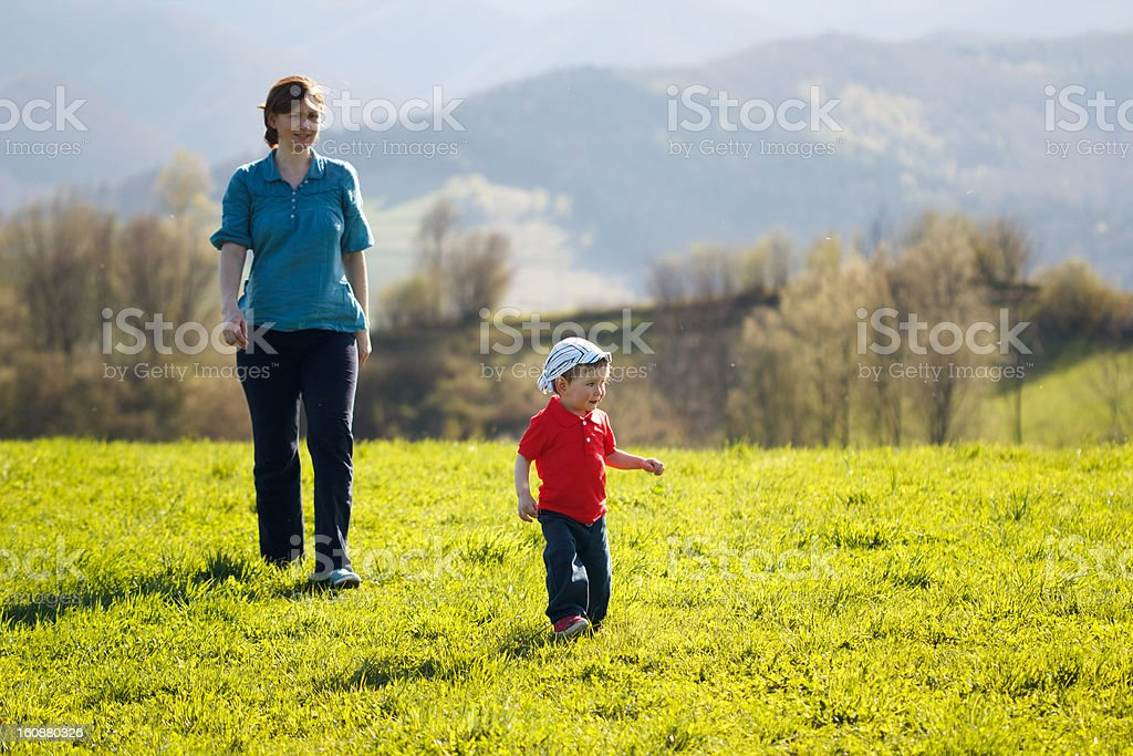Mother with baby - Walk in the mountains at sunset royalty-free stock photo