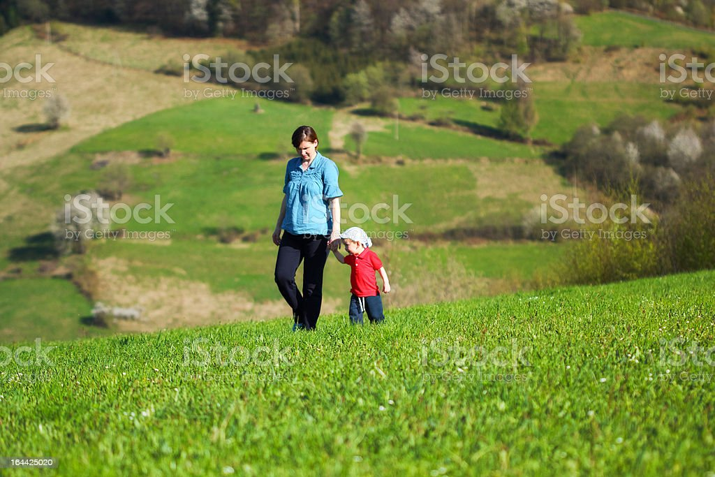 Mother with baby - Walk in the mountains royalty-free stock photo
