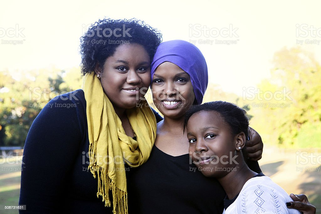 Mother with Cancer and Daughters stock photo