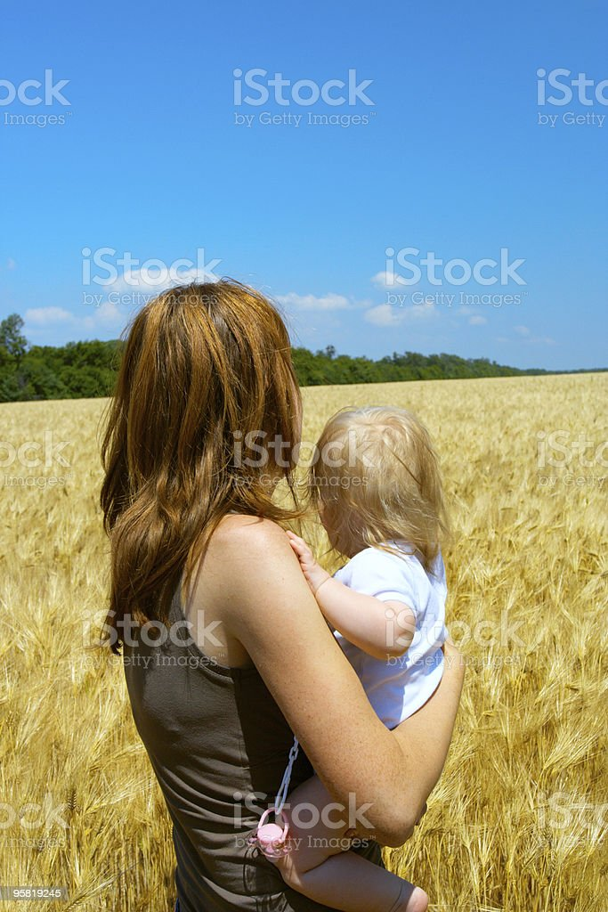 mother with child at the wheat field royalty-free stock photo