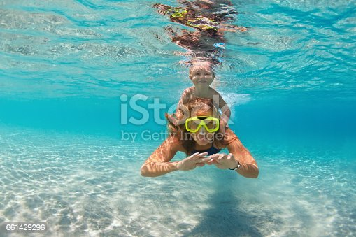 istock Mother with child swim underwater with fun in sea 661429296
