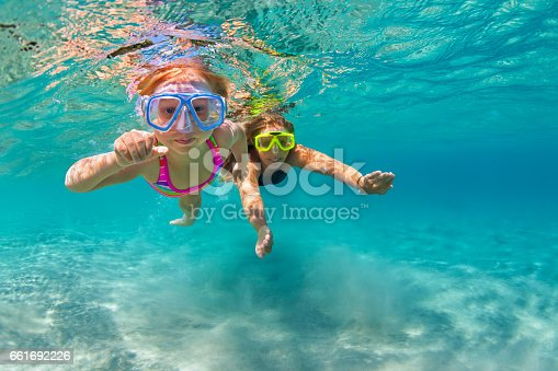 istock Mother with child swim underwater with fun in sea 661692226