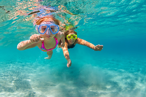 Mother With Child Swim Underwater With Fun In Sea Stock Photo - Download Image Now