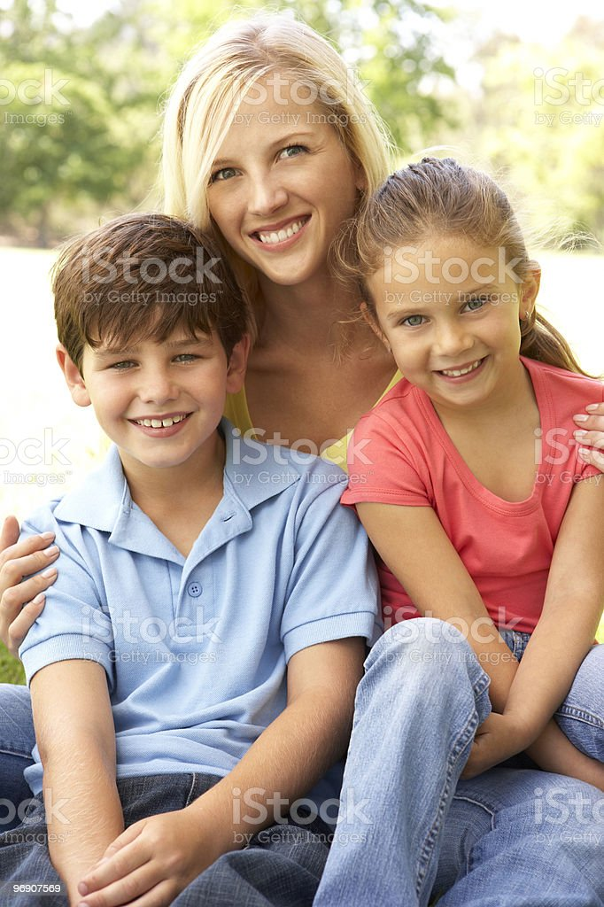 Mother With Children In Park royalty-free stock photo