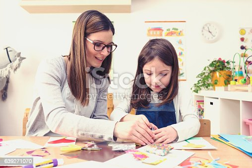 639271192 istock photo Mother with creative kid having fun time together 639271070