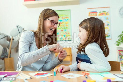 639271192istockphoto Mother with creative kid having fun time together 639404464