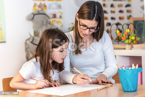639271192istockphoto Mother with creative kid having fun time together 639977994