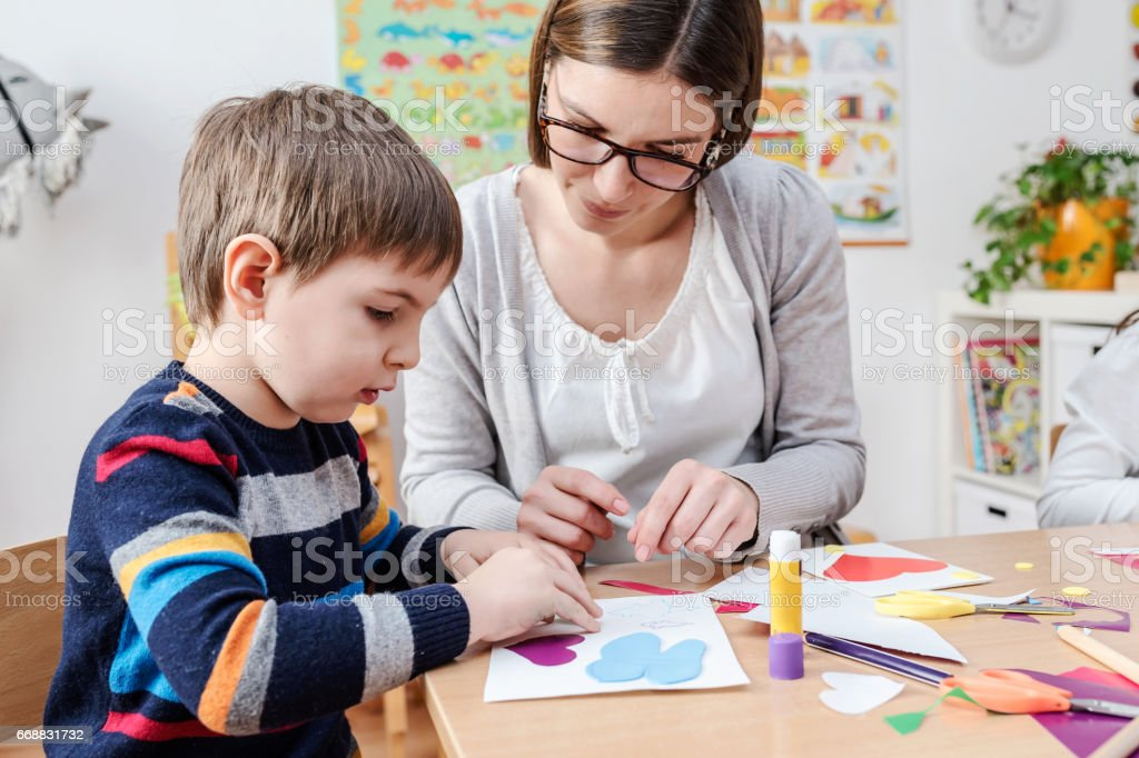 Mother with creative kid having fun time together stock photo