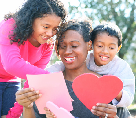 Mother with daughter and son looking at pink cards