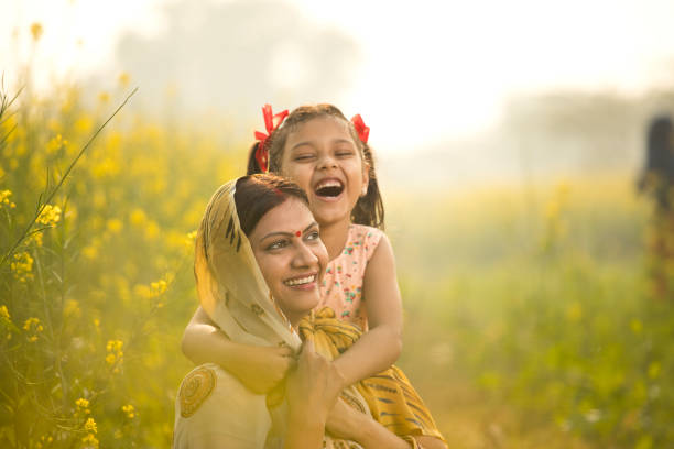 Mother with daughter having fun at agriculture field Rural Indian mother and daughter having fun at agriculture field indian family stock pictures, royalty-free photos & images