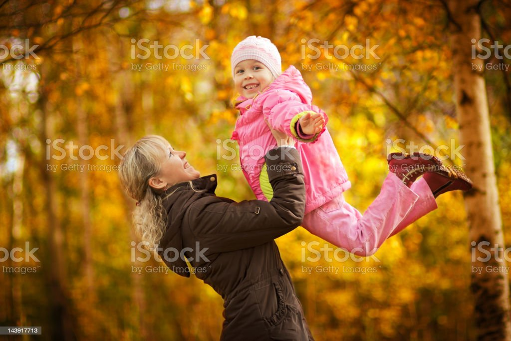 Mother with daughter in autumn park royalty-free stock photo
