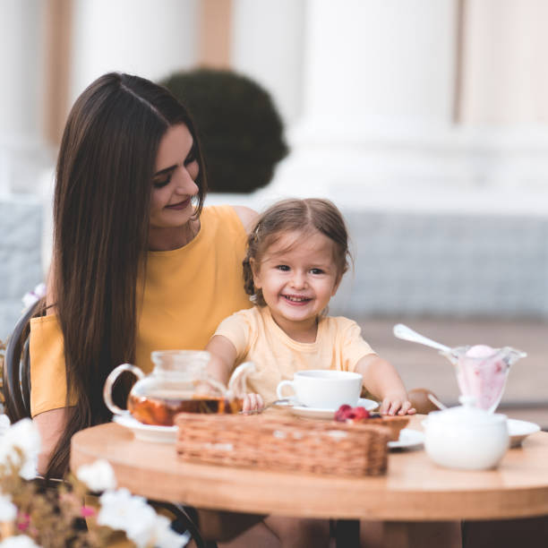 Mother with daughter in cafe stock photo