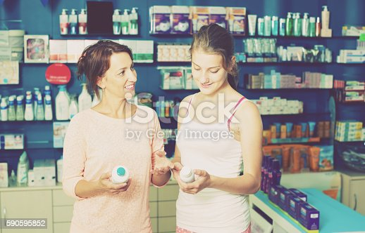 istock Mother with daughter in pharmacy 590595852