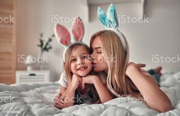 Mother with daughter on bed picture id1135165064?b=1&k=6&m=1135165064&s=612x612&h=jpdpmxubd3n8ew0wqh2wyypt8rmg qix1l1xymrkbdu=