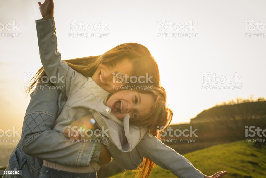 Mother with daughter outdoor. stock photo