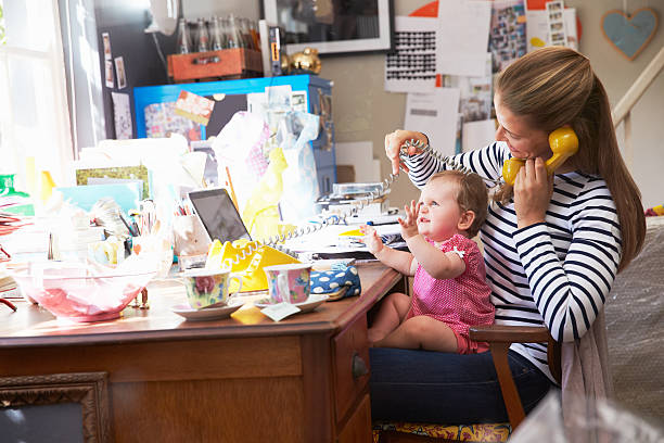 Mother With Daughter Running Small Business From Home Office Mother With Daughter Running Small Business From Home Office messy home office stock pictures, royalty-free photos & images