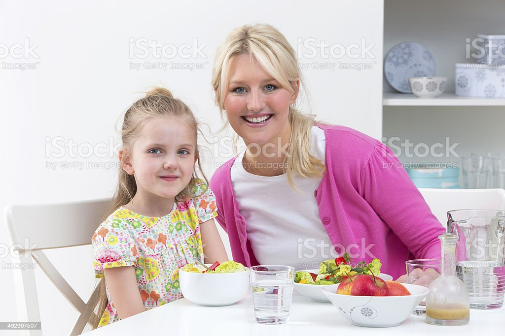 Mother With Disabled Daughter Eating Meal At Home royalty-free stock photo