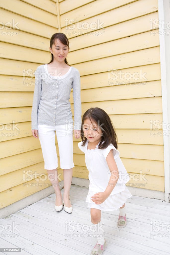 Mother with girl begins to run royalty-free stock photo