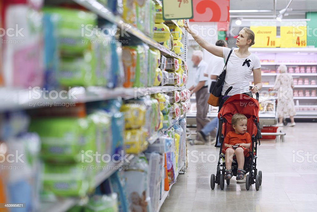 Mother with her boy in the supermarket royalty-free stock photo