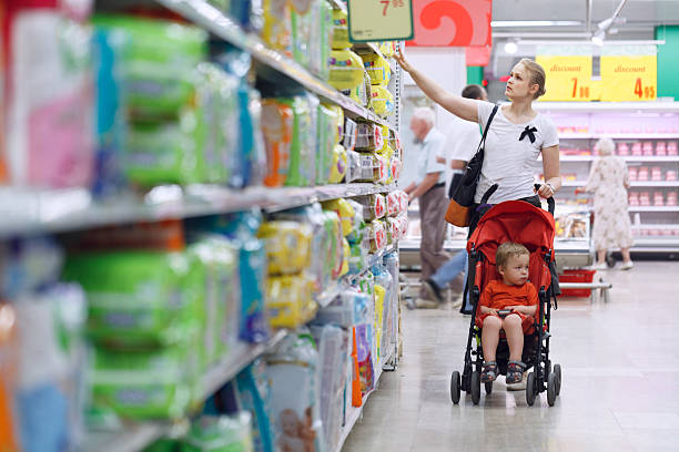 Mother with her boy in the supermarket stock photo