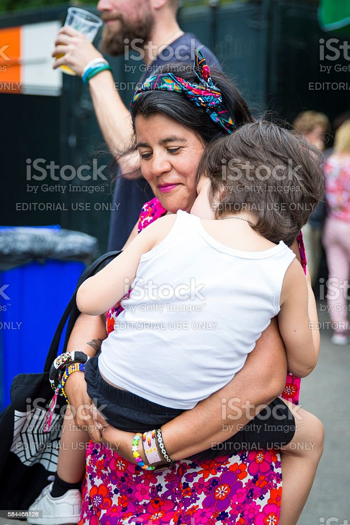 mother with her chil in her arm, Gay EuroPride Amsterdam stock photo