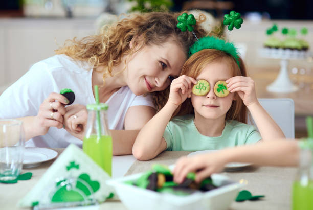 mother with her child having a fun - st patricks day food stock photos and pictures