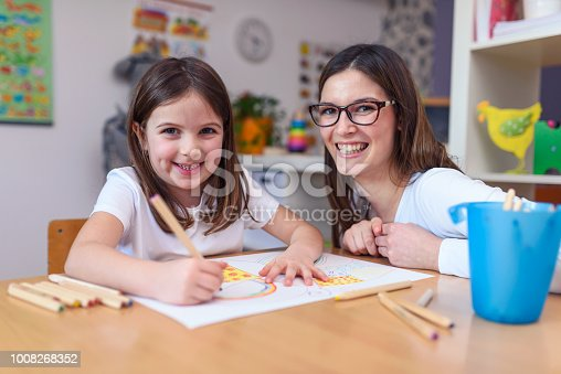 639271192 istock photo Mother with her child having creative and fun time drawing 1008268352
