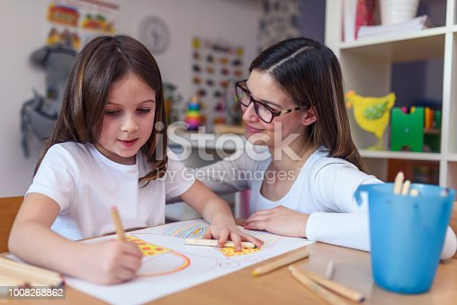 639271192 istock photo Mother with her child having creative and fun time drawing 1008268862