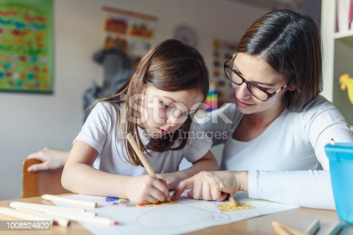 639271192 istock photo Mother with her child having creative and fun time drawing 1008524920