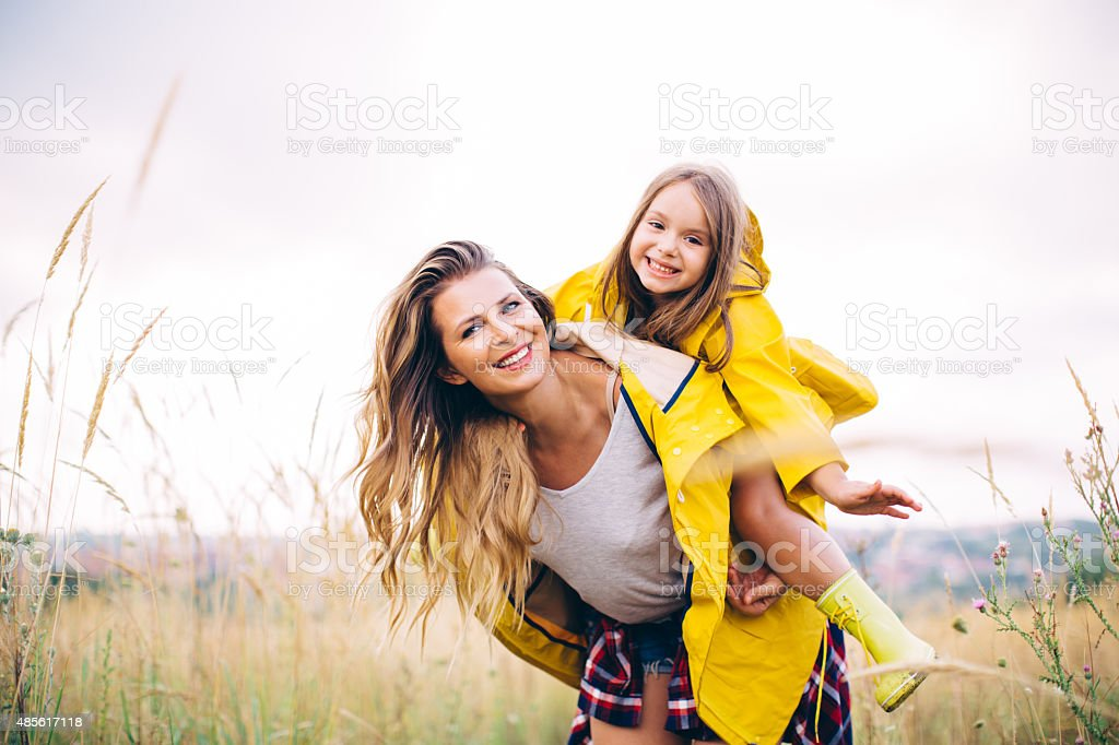 Mother with her cute daughter in meadow. stock photo