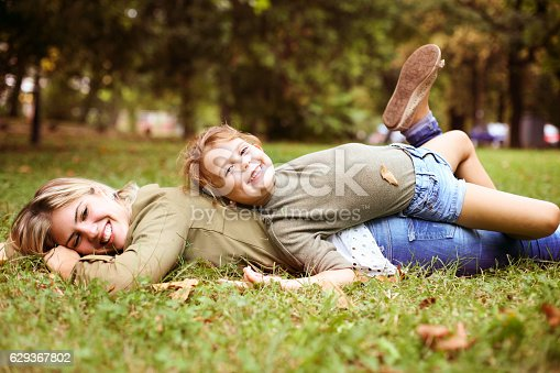 466231012istockphoto Mother with her daughter in the park. 629367802