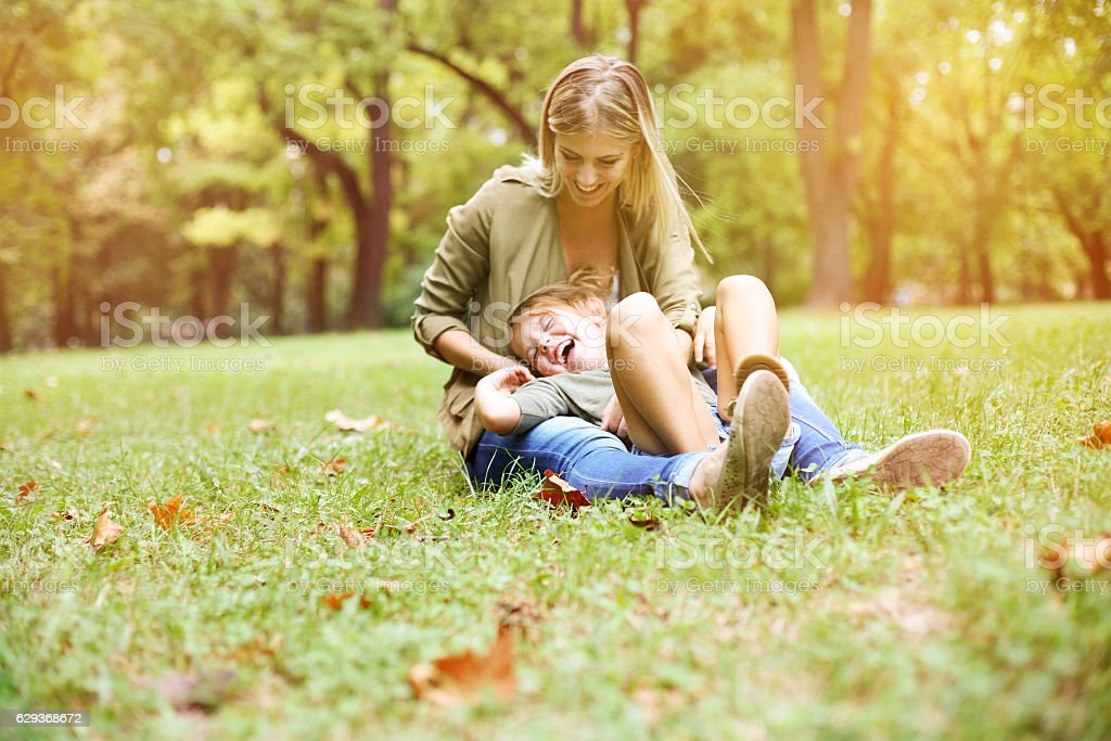 Mother with her daughter in the park. stock photo