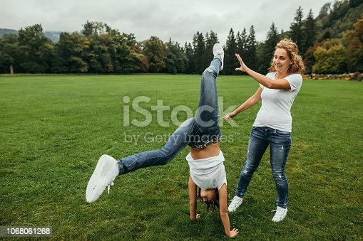 Mother with her daughter on a playground