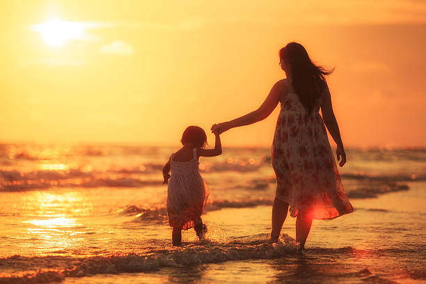 mother with her daughter on the beach - philippines girl stock photos and pictures