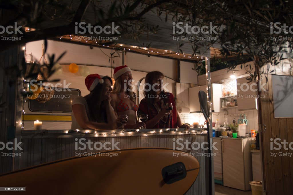 Mother with her daughter\'s on new year evening in their summer home