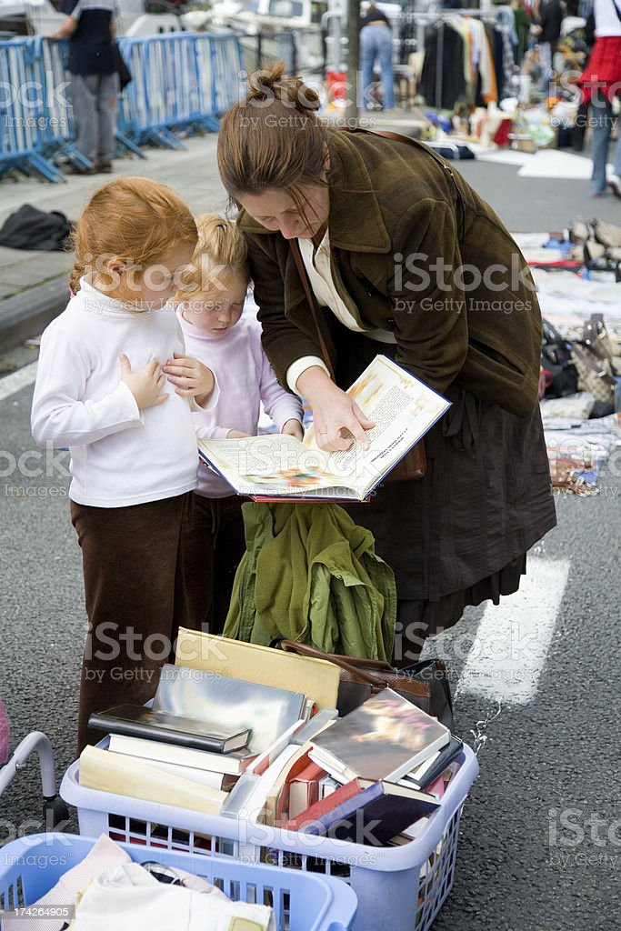 Mother with her girls at the flea market royalty-free stock photo